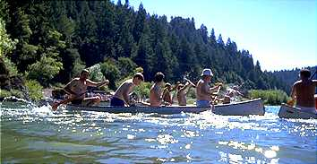 Four man canoe race at the Bohemian Grove.