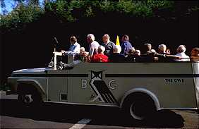 A shuttle bus enters the Bohemian Grove.